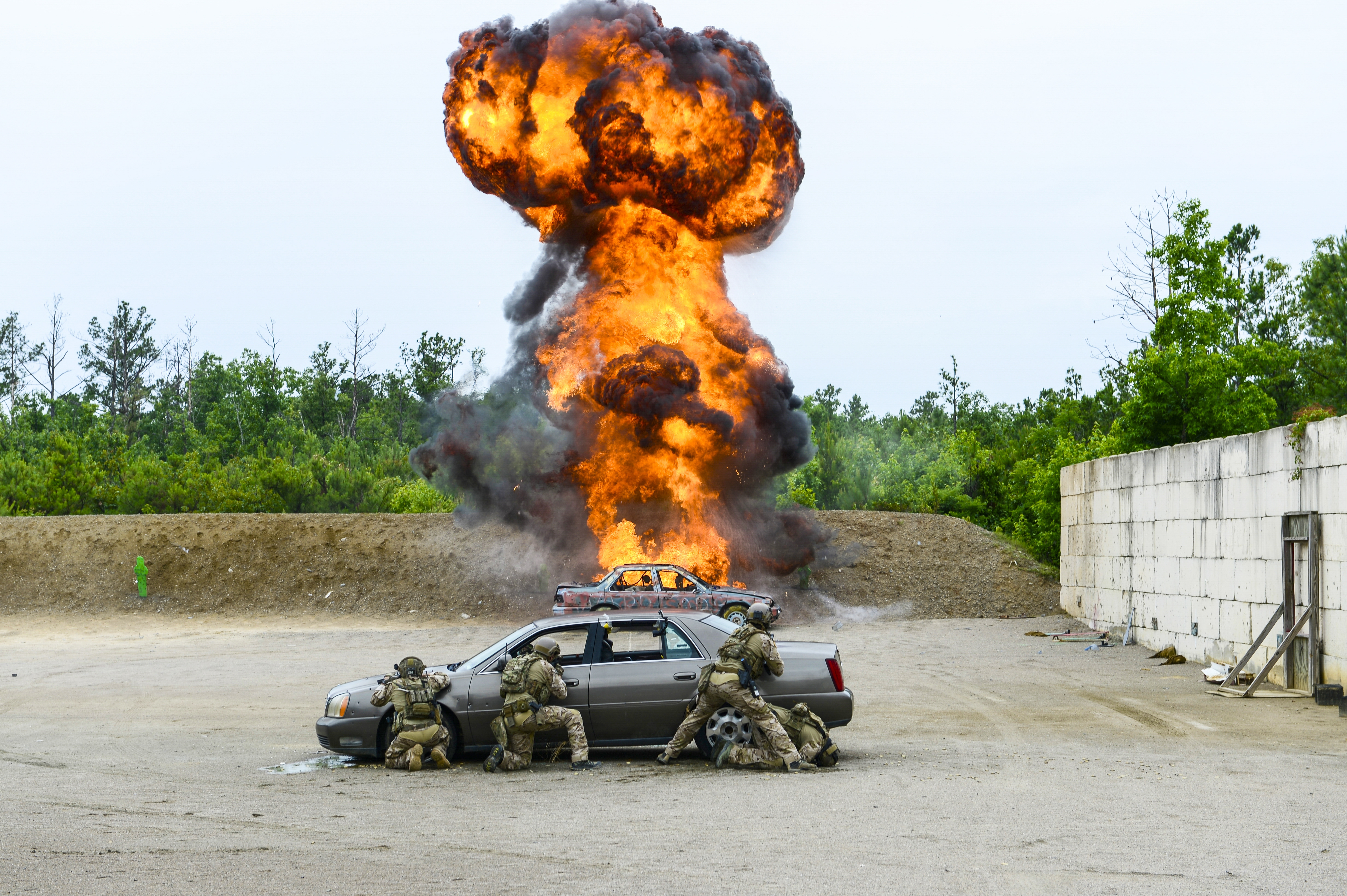 Army special operators engage an enemy vehicle