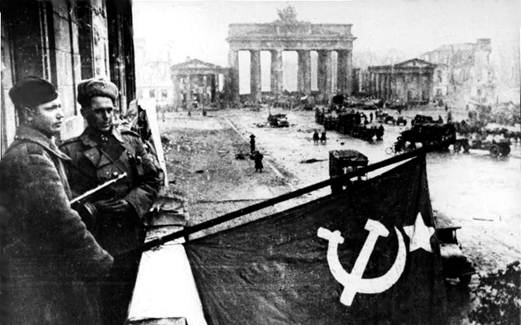 Russian soldiers hoist their red flag in Berlin on the 2nd of May.