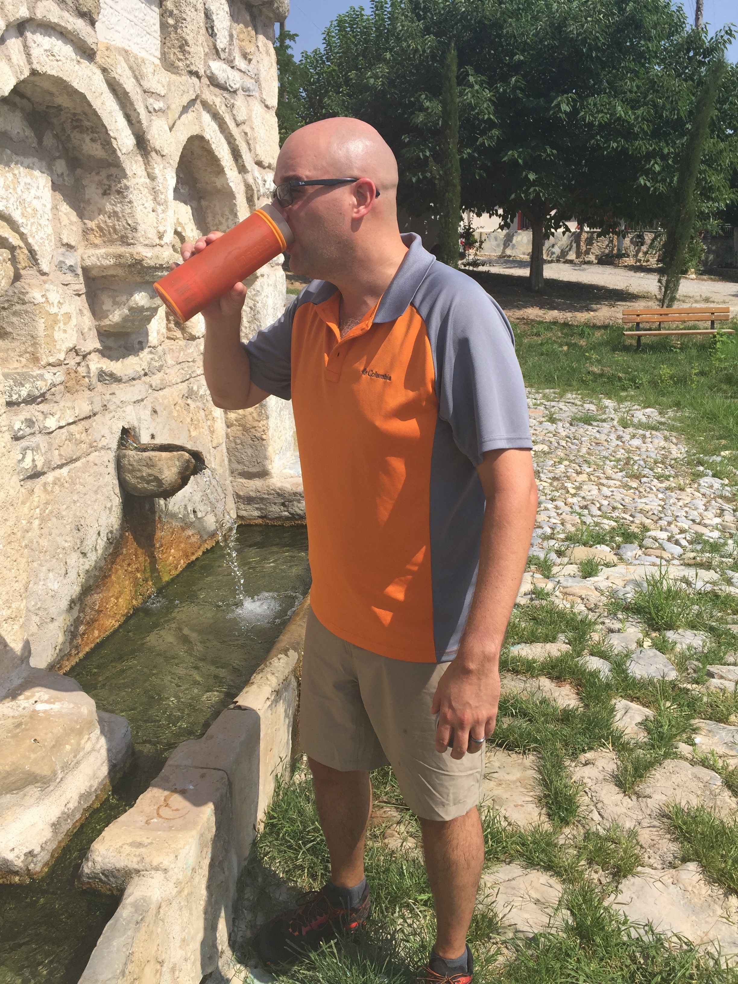 Mike Livingston drinks from the spring at Zoodochus Pigi, where the Roman troops got their water.