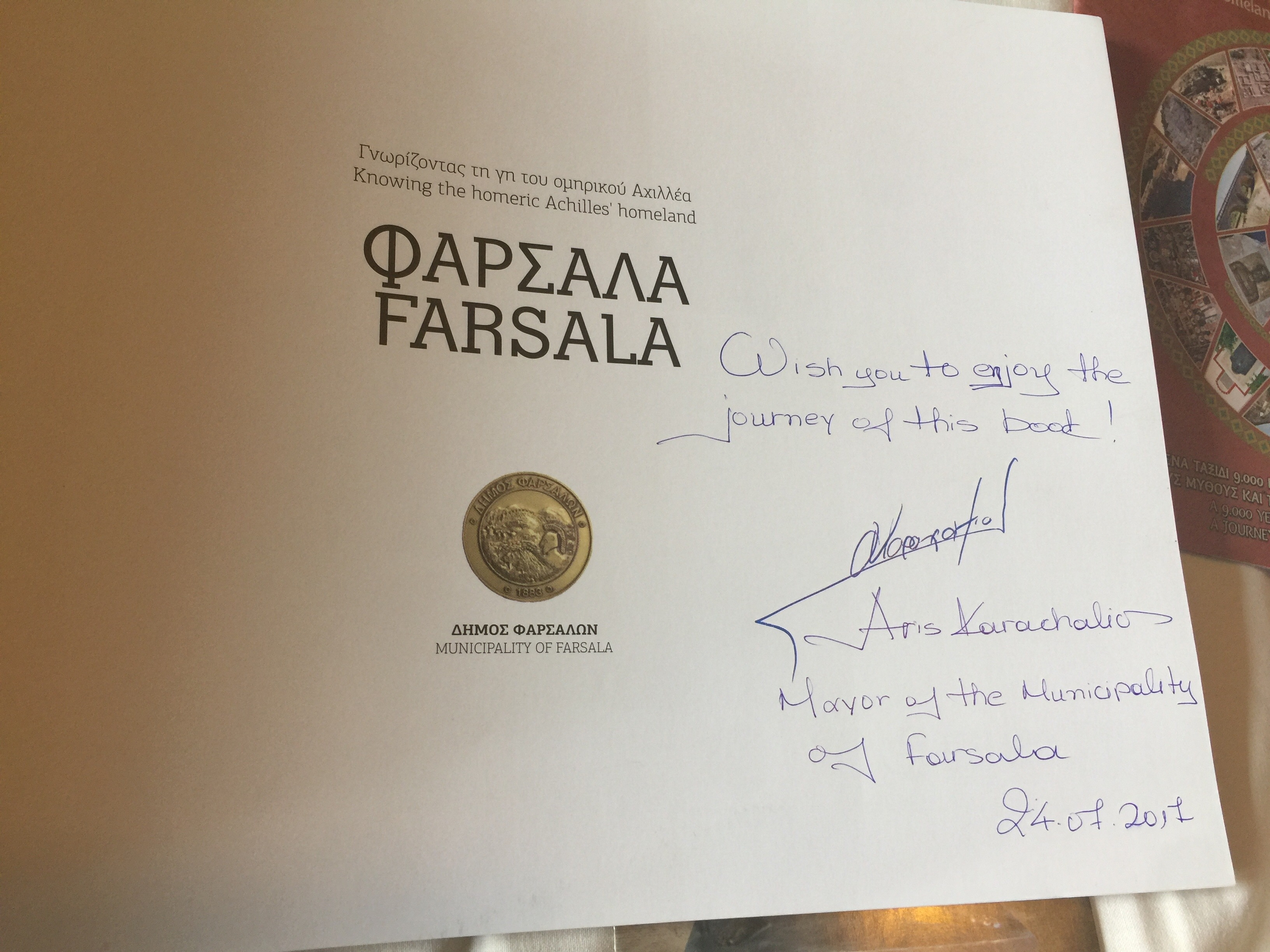 The mayor of Farsala gifted us autographed guides to the district!