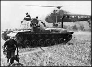 Helicopter evacuates casualties, while a Patton tank stands by.
