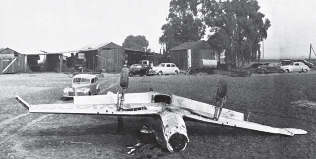 In a field close to Mines Field lies the undignified wreckage of the once-pristine NA-73X on November 20, 1941. After being airborne for just 12 minutes after takeoff, test pilot Paul Balfour neglected to switch to the correct fuel tank, starving the engine of fuel. (NAA)