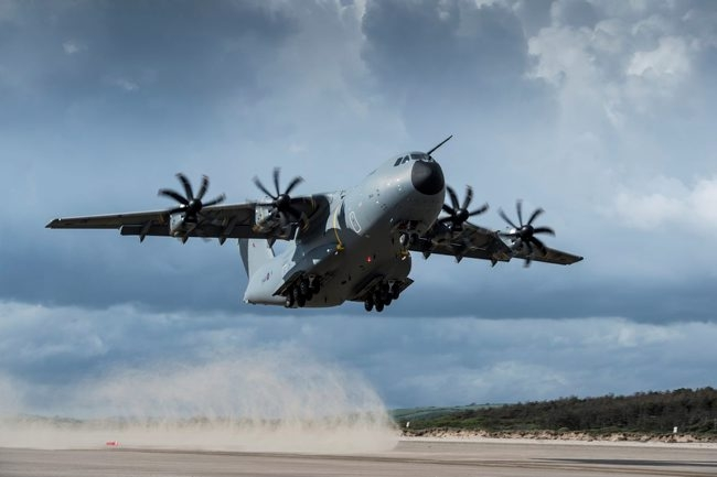 RAF A400M Atlas transport aircraft carrying out a series of spectacular test landings and take offs on a beach in South Wales.